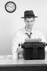 Photo of journalist at typewriter