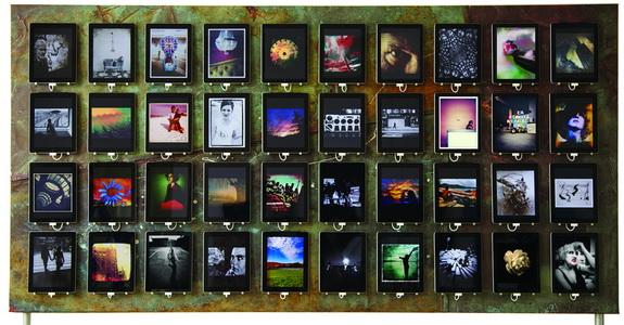 Image of 40 iPads displaying iPhone artwork at studio b
