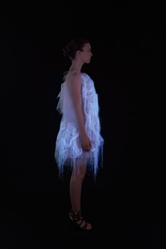 "For a project entitled ""[No]Where, [Now]Here,"" Ying Gao created two dresses that combine super organaza, photoluminescent thread and embedded eye-tracking technology to create a dress. The luminosity of the thread is activated by the spectator's gaze. (www.yinggao.com)"